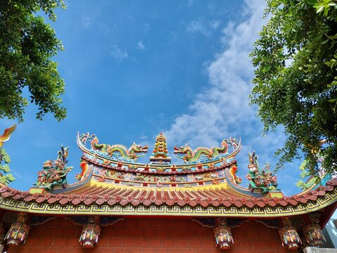 an ping, ancient, anecdotes, architectural, top religious oriental sculpture on the roof of Taiwan temple with blue sky design for holy and belief concept