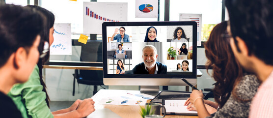 Obraz Group of professional asian business meeting and discussing strategy with new startup project.Creative business people video conference online meeting with business colleagues team in modern office - fototapety do salonu