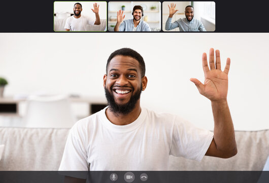 Youn men making online videochat at home, waving hands