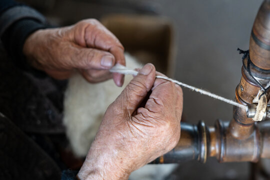 Thread in the Old spinning wheel. carpet making. close up
