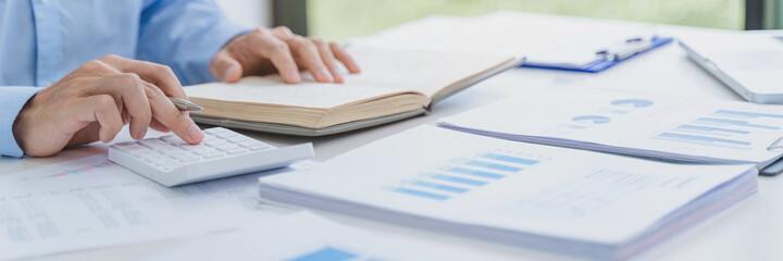 Fototapeta Man Analysis Business Accounting working withIndividual income tax return.Accounting obraz