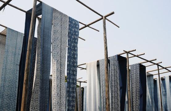 Chinese blue print batik fabrics hanging to dry outdoor. Shot in Wuzhen, China.