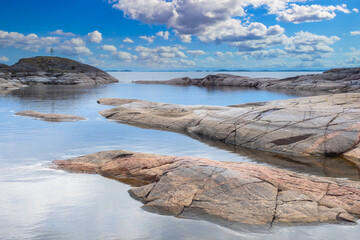 Karelian landscape. The nature of Russia. Beautiful sky over Ladoga. Rocky islands in the lake. Sky, water, and rocks. Ladoga skerries. Natural landscape. Northern nature. Russian scenery.