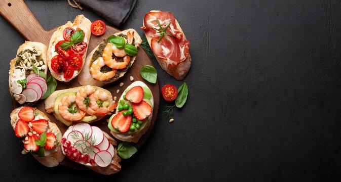 Appetizers board with traditional spanish tapas set. Italian antipasti brushetta snacks