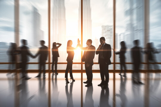Successful businesspeople hi-fiving in blurry office interior with sunlight. Success and work ethics concept.