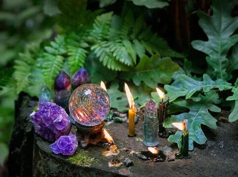 candles, minerals, magic crystal ball in forest, natural background. meditation, relaxation, Witchcraft concept. healing gemstone. spiritual ritual for cleaning aura. wiccan witch altar