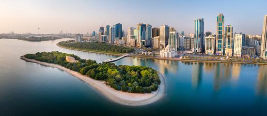 Fototapeta Sharjah aerial panorama above Al Noor island and mosque and downtown rising above Khalid lake obraz