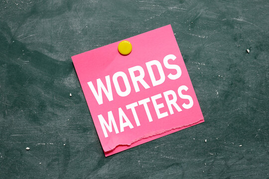 words matter. lettering on pink sticker attached to chalkboard