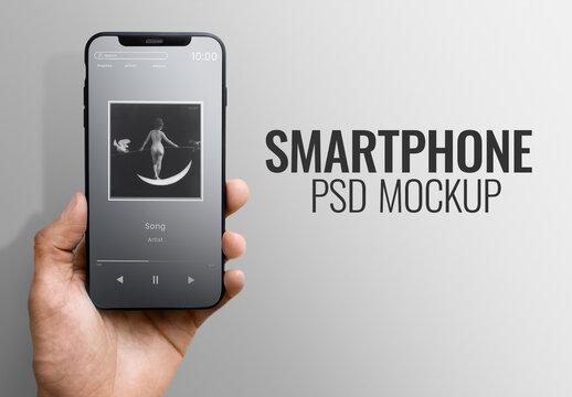 Hand Holding Smart Phone Mockup