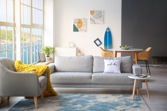 Interior of modern room with surfboard