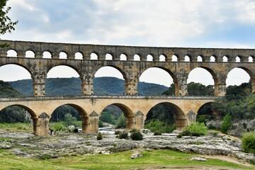 Obraz pont du gard, photo as a background , in Pont du gard, gardon, nimes france - fototapety do salonu