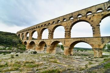 Obraz pont du aqueduct in france, photo as a background , in Pont du gard, gardon, nimes france - fototapety do salonu