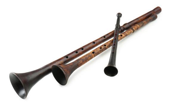 Vintage bryolkas on white background. Woodwind musical instruments