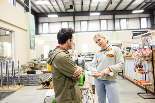 Worker assisting customer in home improvement store