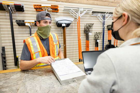 Workers wearing facemask working in home improvement store
