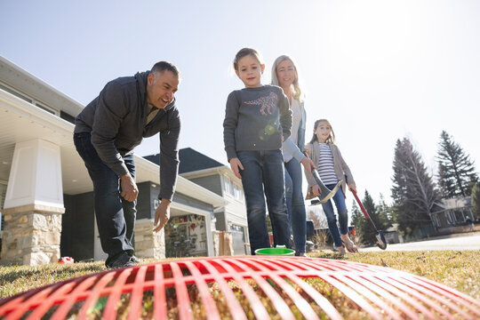 Cheerful family preparing to clean up yard