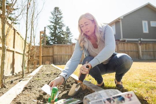 Portrait of woman gardening in backyard