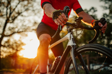 Obraz Close up of man riding bike - fototapety do salonu
