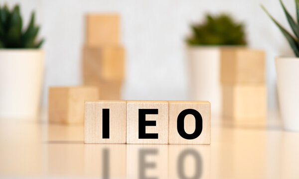 Wood block word IEO Cryptocurrency blockchain business banner concept. Blockchain technology