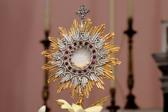 Monstrance (Ostensory) with the Blessed Sacrament in the Church of the Sacred Heart of Jesus in Chiaravalle, Calabria (Italy). The Host bears the inscription JHS, monogram of the name of Jesus