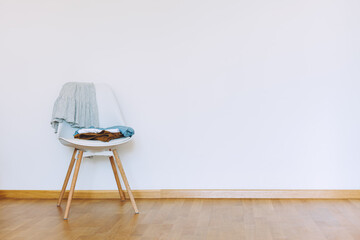 Obraz Indoors flat wall mockup with Clothes on Chair - fototapety do salonu