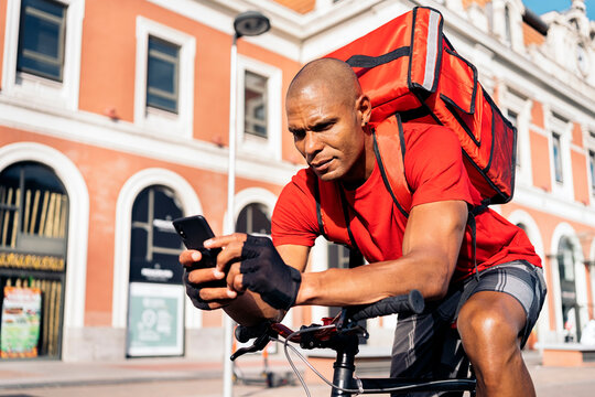 African American Rider Using Phone