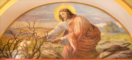VIENNA, AUSTIRA - JUNI 18, 2021: The symbolic fresco of Jesus good Sheepherd in Herz Jesu church from begin of 20. cent. by autor with F.Z. initials.