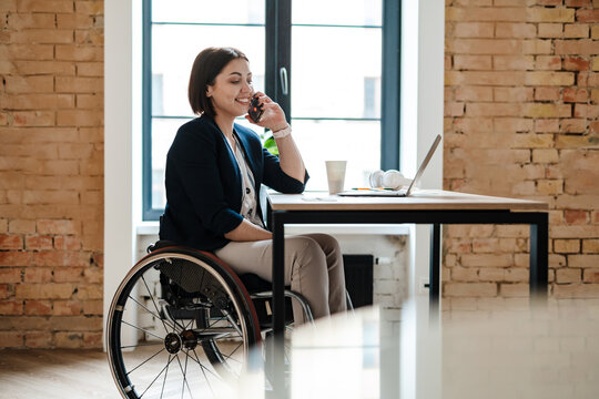 Young disabled business woman in wheelchair working
