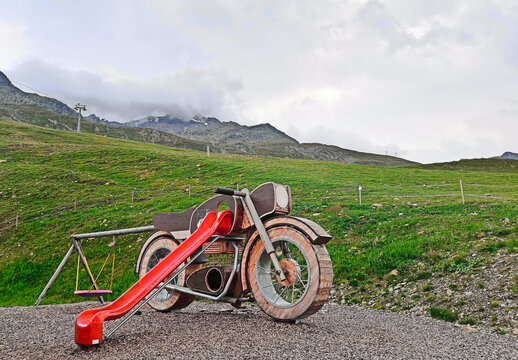 park with motorcycle shaped red slide