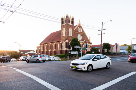 Car crossing intersection with traffic lights on Glebe Rd, Adamstown, Newcastle