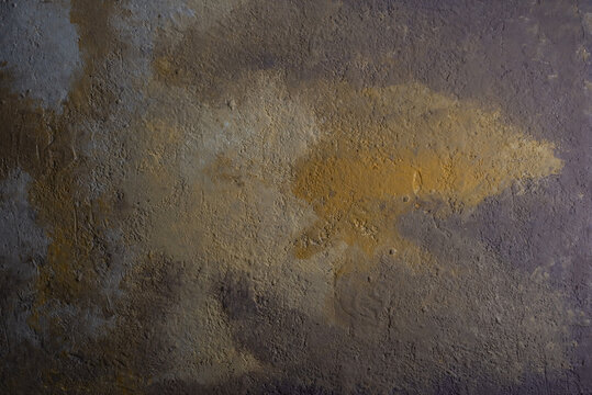 fragment of wall background texture of warm tone yellow-brown color with patterns