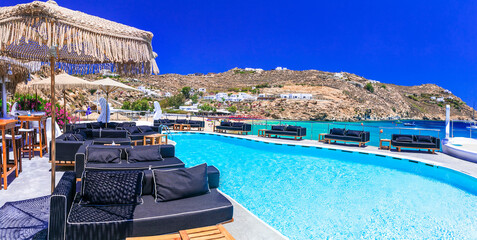 Luxury greek holidays. Stunning Mykonos island. famous Super Paradise beach with relaxing bar' zone with swimming pool