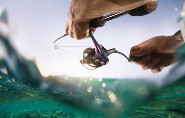 Fototapeta Fishing blurred background. Fisherman with spinning on the sea. obraz
