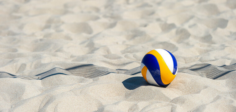 Beach volleyball ball on the sand beach. Team sport concept