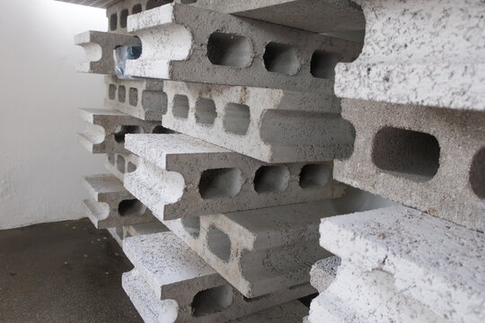 stack of gray concrete construction blocks isolated.