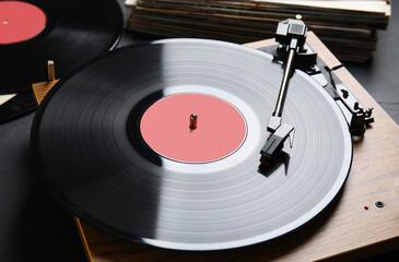 Fototapeta Modern vinyl record player with disc on black background, closeup obraz