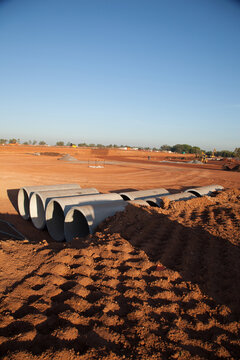 Large cement pipes arranged on a large industrial building site