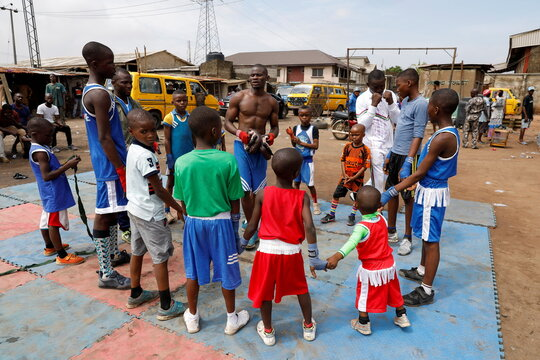 Kid boxers train at an outdoor boxing gym in Adura playground, in Lagos