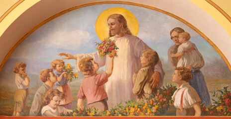 VIENNA, AUSTIRA - JUNI 18, 2021: The fresco of Jesus among the children in Herz Jesu church from begin of 20. cent. by autor with F.Z. initials.