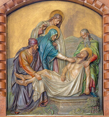 VIENNA, AUSTIRA - JUNI 18, 2021: The relief of the Burial of Jesus in the Herz Jesu church from begin of 20. cent. by Workroom from Munich.