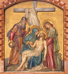 VIENNA, AUSTIRA - JUNI 18, 2021: The relief of Deposition of the cross in the Herz Jesu church from begin of 20. cent. by Workroom from Munich.