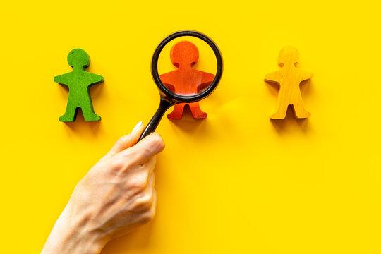 Wooden human figures - mediator arbitrator conflict resolving