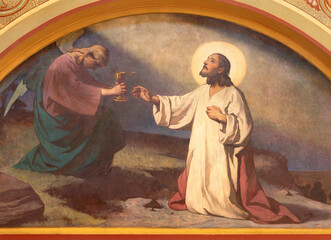 VIENNA, AUSTIRA - JUNI 18, 2021: The fresco of Jesus prayer in Gethsemane garden in Herz Jesu church from begin of 20. cent. by autor with F.Z. initials.