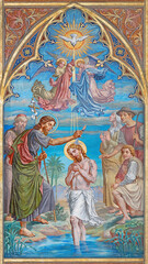 VIENNA, AUSTIRA - JUNI 24, 2021: The fresco of the Baptism of Jesus in the Votivkirche church by brothers Carl and Franz Jobst (sc. half of 19. cent.).