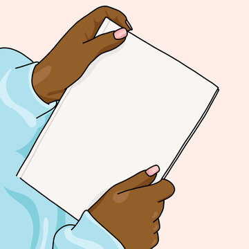 hands holding a white book