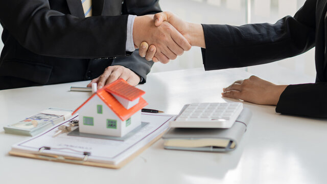 Sales agents offer home purchase contracts or discuss loans and interest rates, home buying and renting ideas.