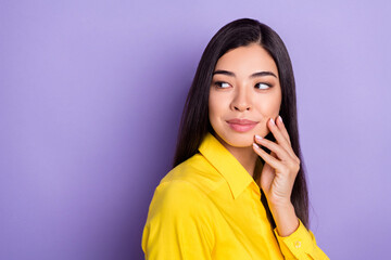 Photo of think brown hairdo young lady look empty space wear yellow shirt isolated on purple background Wall mural