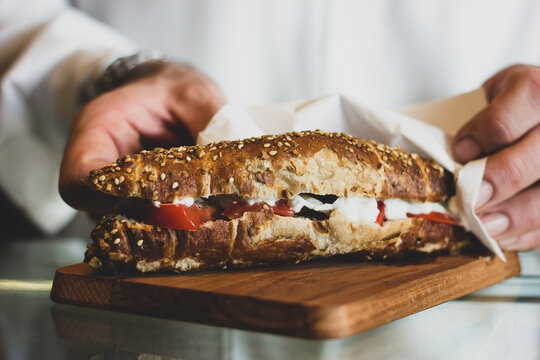 Sandwiches with fried meat, tomatoes, mayo, vegetables and boiled eggs