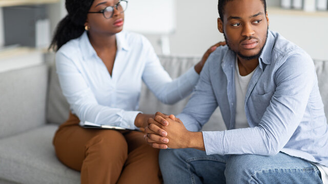 Depressed black former soldier suffering from PTSD, undergoing military rehab, consulting with psychotherapist