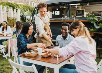 Fototapeta Multiracial people having fun eating at food truck outdoor - Focus on left girl face obraz